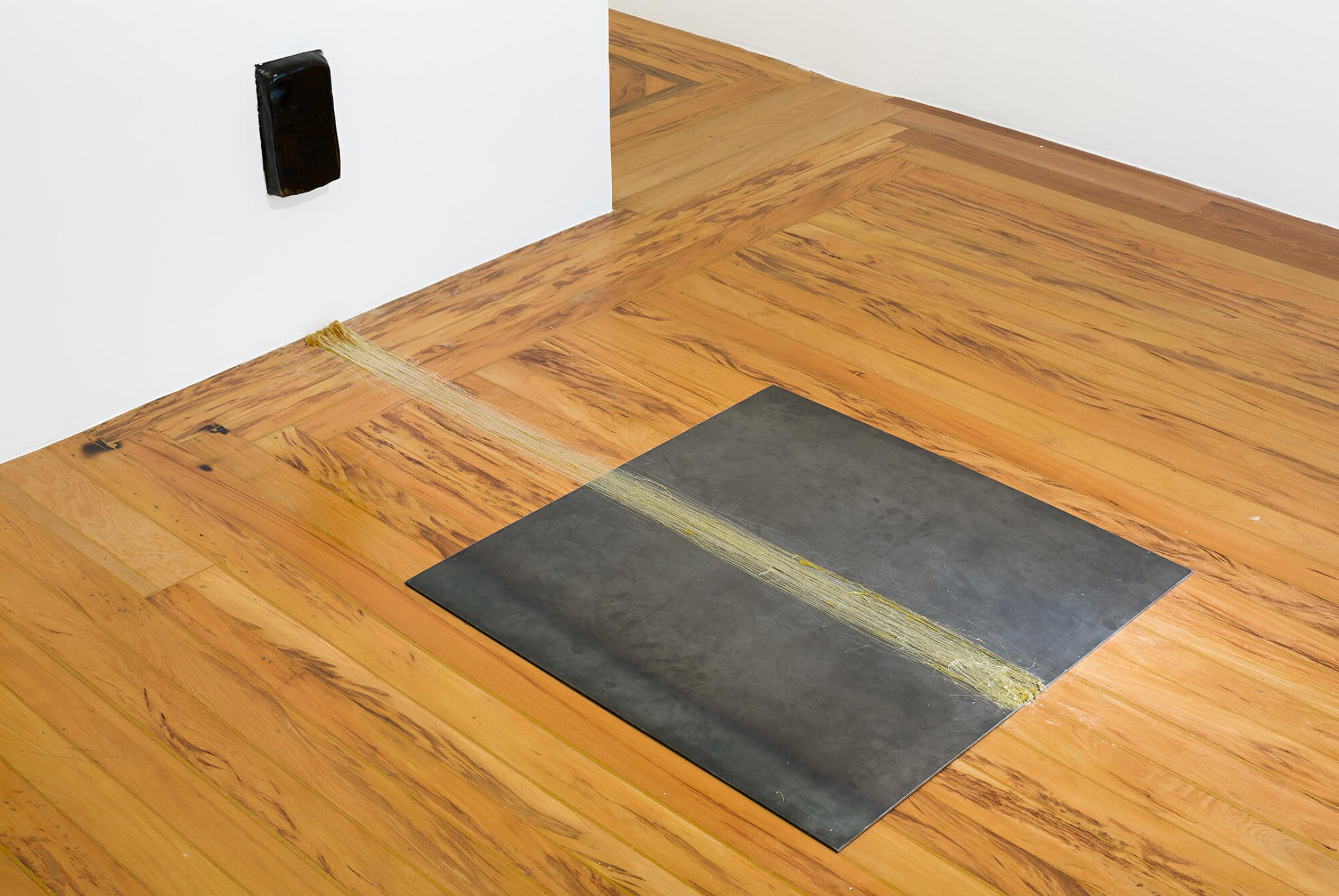 Paloma Bosquê, <em>A Step Under</em>, 2014, pitch and iron plaque, 58 × 90 ×  170 cm - Mendes Wood DM