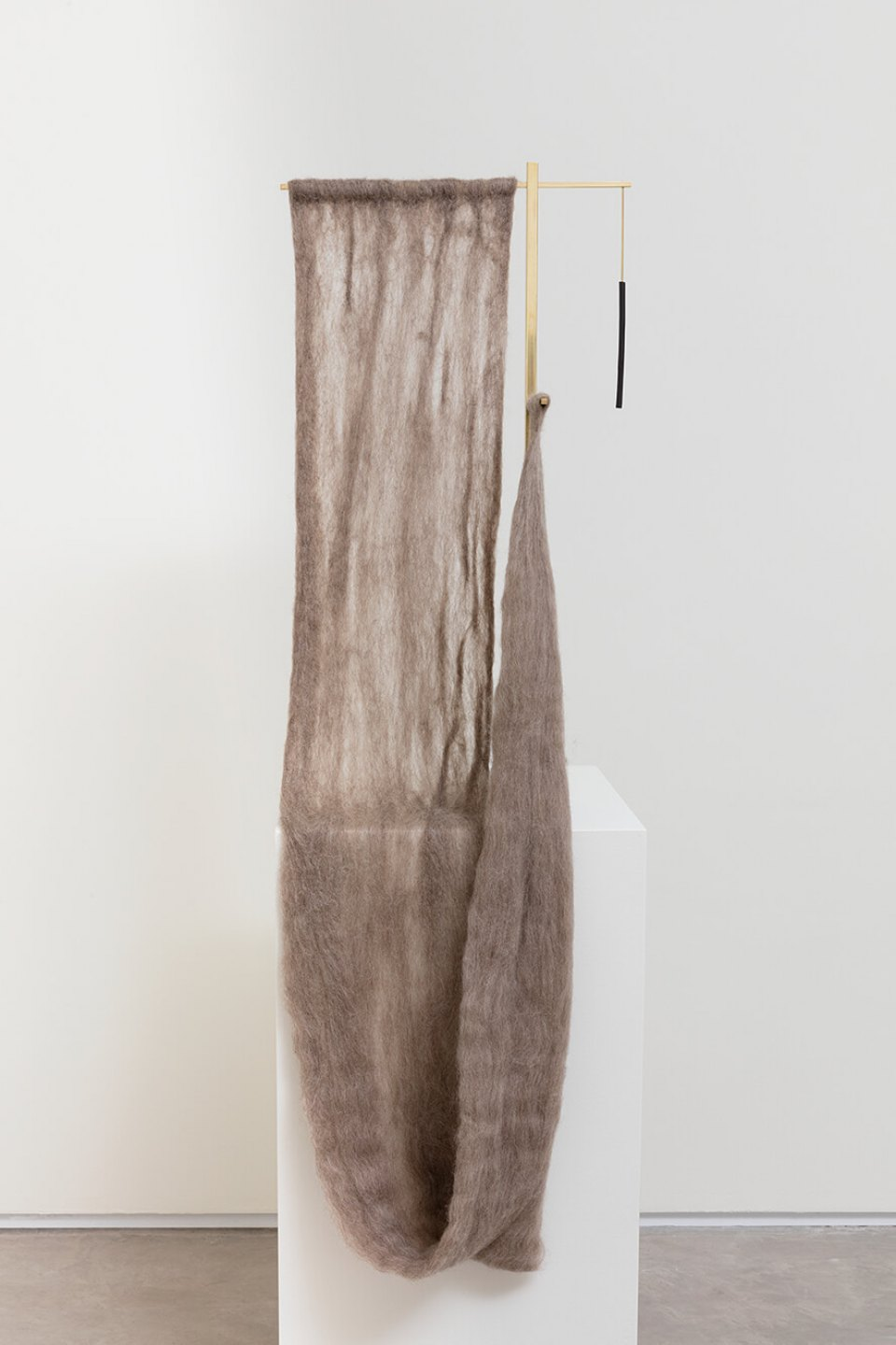 Paloma Bosquê,<em> Cross</em>, 2016, wool felted by hand, brass rods and charcoal, 120 × 14 × 38,5 cm - Mendes Wood DM