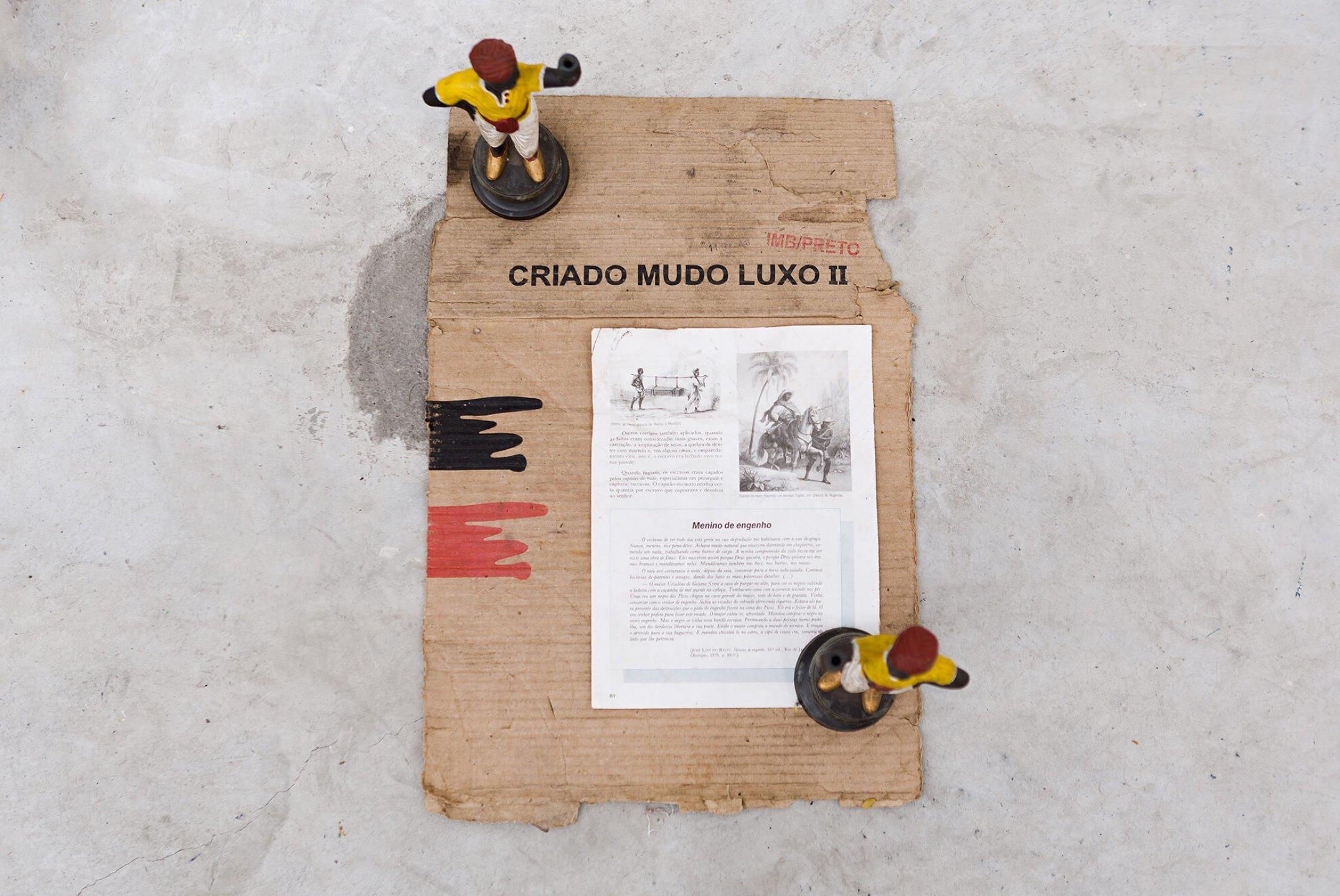 Paulo Nazareth, <em>CA - criado mudo,</em>&nbsp;2013, bronze sculptures, cardboard and paper, 51 × 34 × 24 cm<br> - Mendes Wood DM