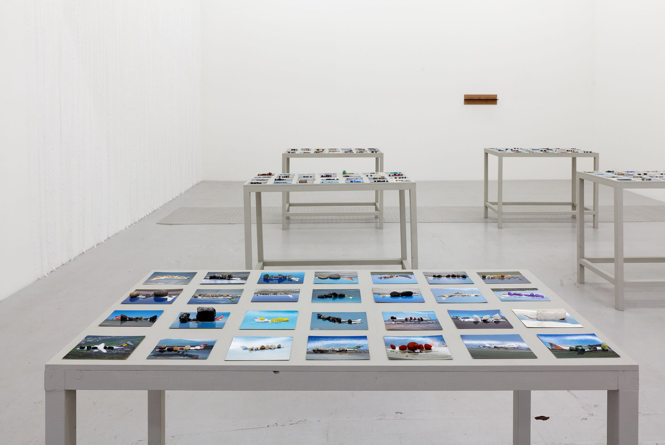 Runo Lagomarsino,<em>OtherWhere,</em> 2011, 168 postcards and stones, 6 painted wooden tables, 100 × 133 × 59 cm (each) - Mendes Wood DM