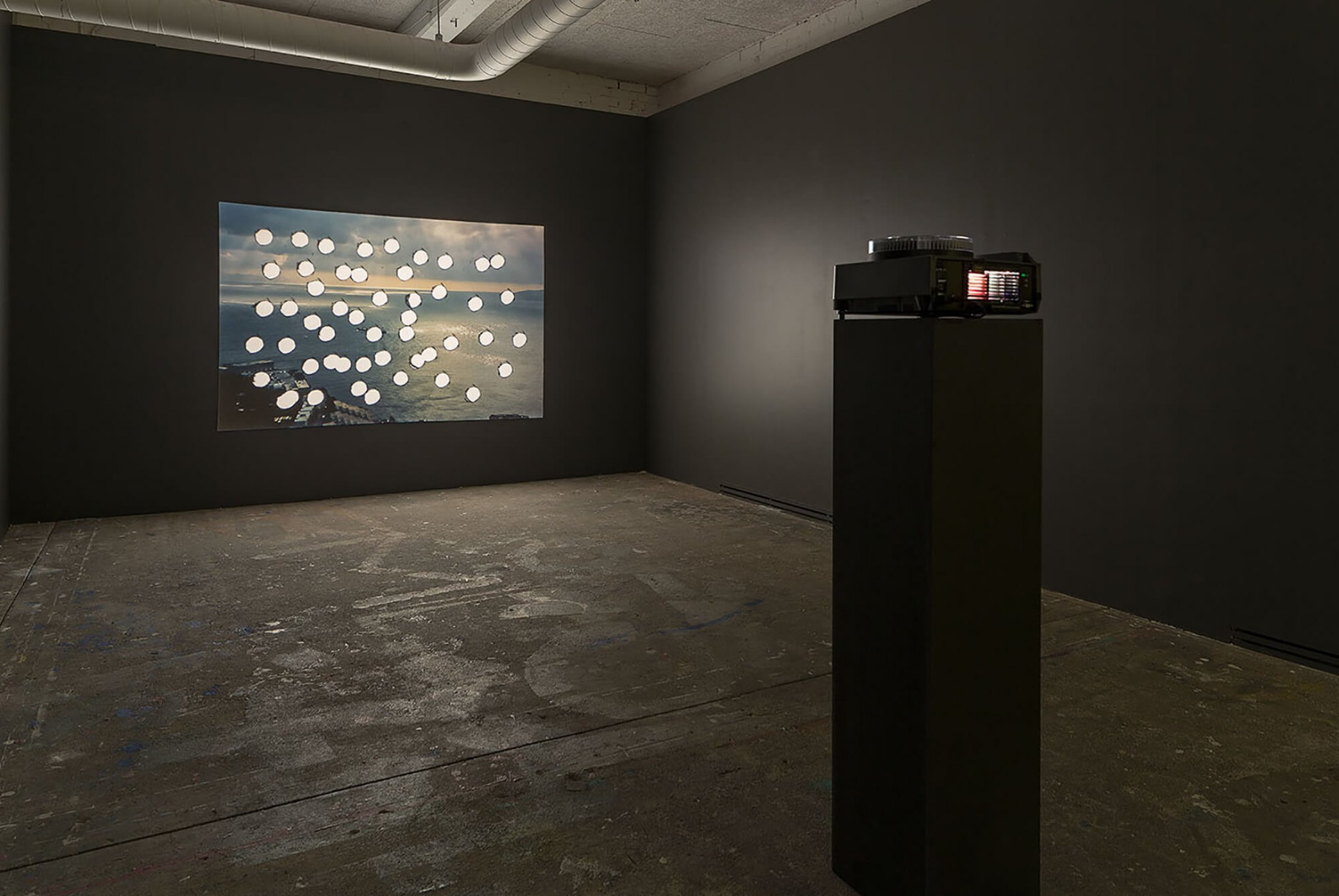 Runo Lagomarsino,<em>Sea Grammar,</em>2015, projection loop, 80 perforated images in a carrousel of projector slide with timer, 1 original image,variable projection image - Mendes Wood DM