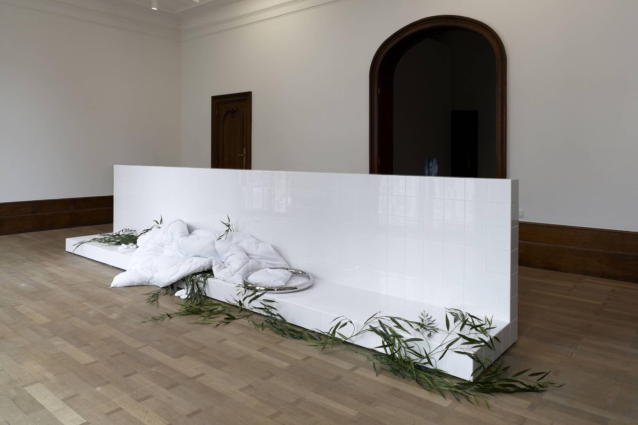 Prem Sahib,<em> Heron,&nbsp;</em>2017, socks, wood, ceramic tiles, grout, polished steel, duvet, artificial willow branches, 105 × 510 × 75 cm - Mendes Wood DM