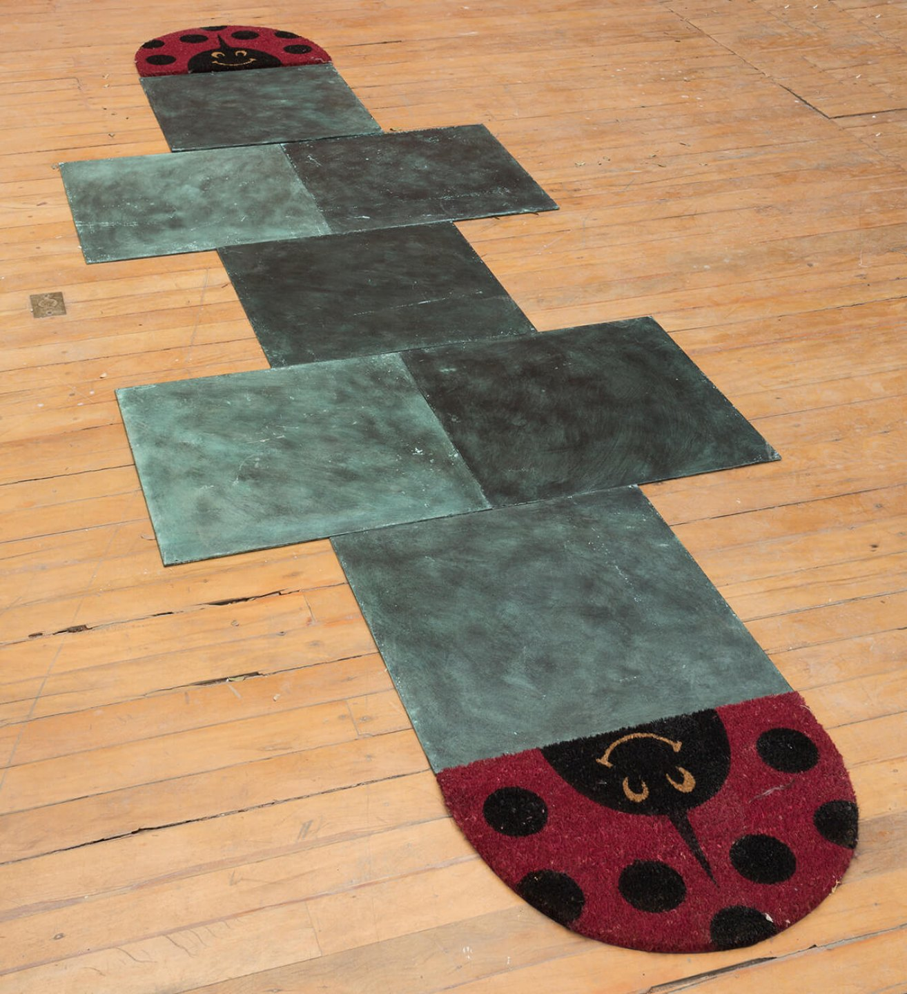 Adriano Costa, <em>To hell and heaven is missing 3</em>, 2014, 7 bronze plaques and carpets, 380 × 120 cm - Mendes Wood DM