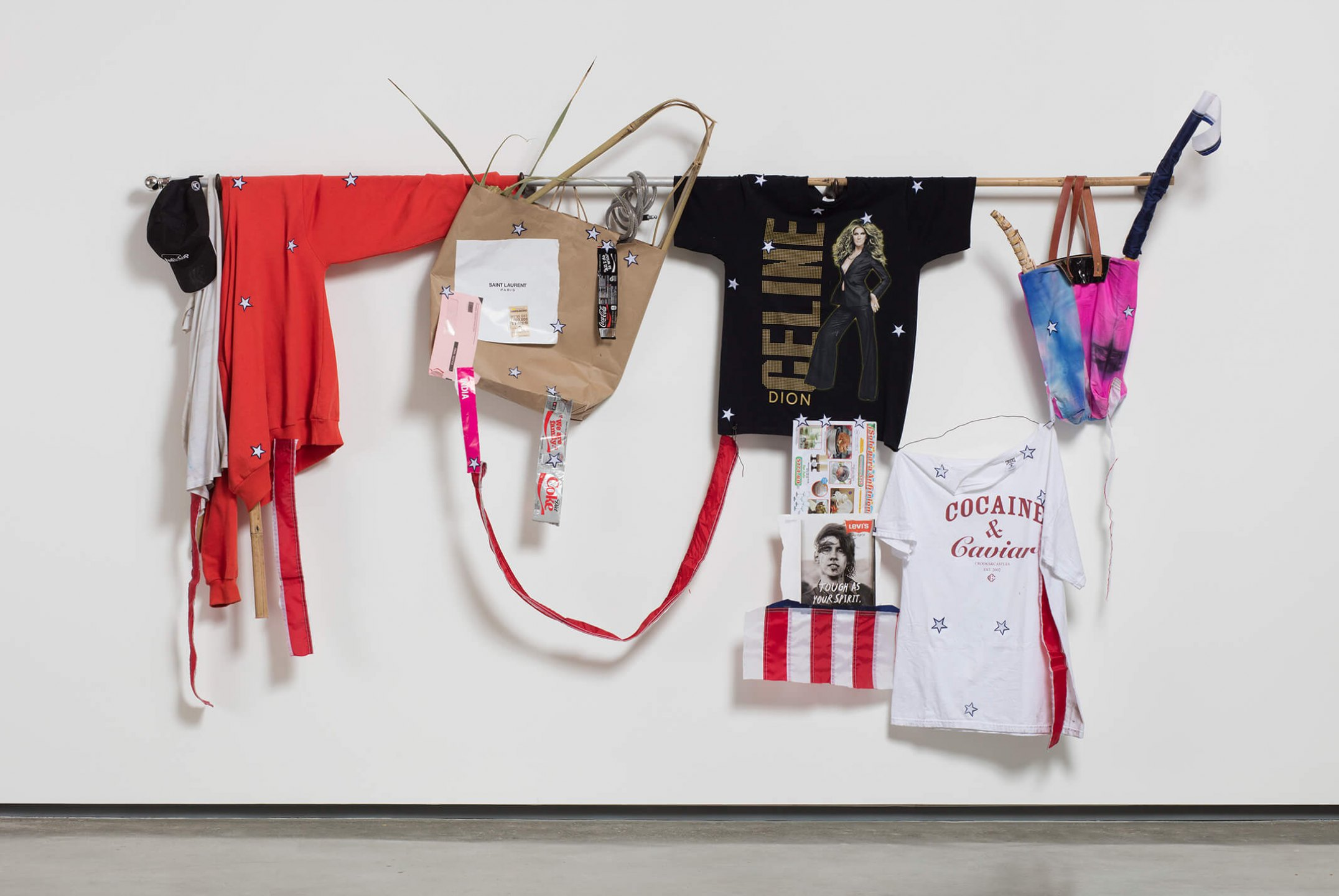 Adriano Costa, <em>Celine</em>, 2016, bronze, American flag, clothes, bamboo, sugarcane and various found objects, 170,2 × 261,6 × 48,3 cm - Mendes Wood DM