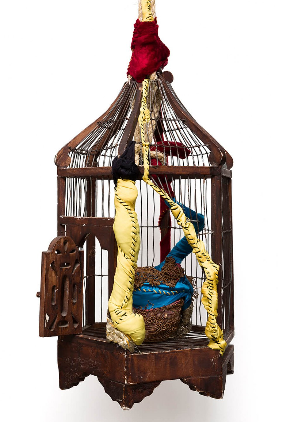 Sonia Gomes, <em>Gaiola</em>, 2016, stitching, bindings, different fabrics and laces wire and wood cage, 185 × 29 cm ø - Mendes Wood DM