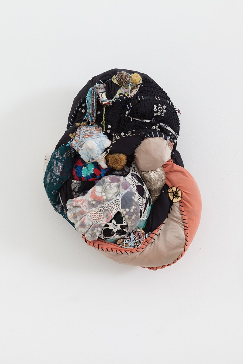 Sonia Gomes,<em>untitled – Patuás series</em>,2016, stitching, bindings, different fabrics and laces, 17×37×30 cm - Mendes Wood DM