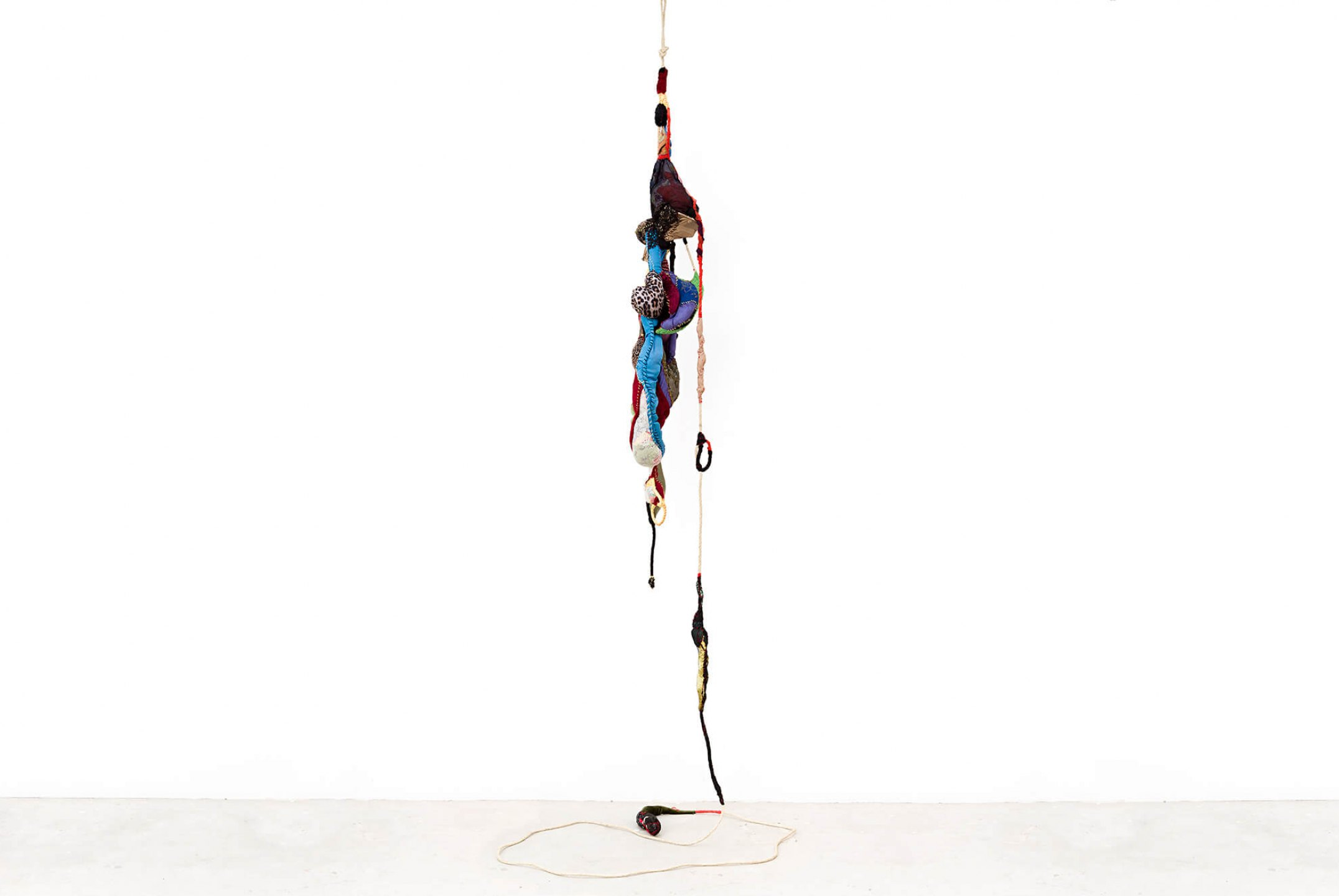 Sonia Gomes,<em>untitled</em>, 2015, stitching, bindings, different fabrics and laces on wire, 300×45 cm ø - Mendes Wood DM