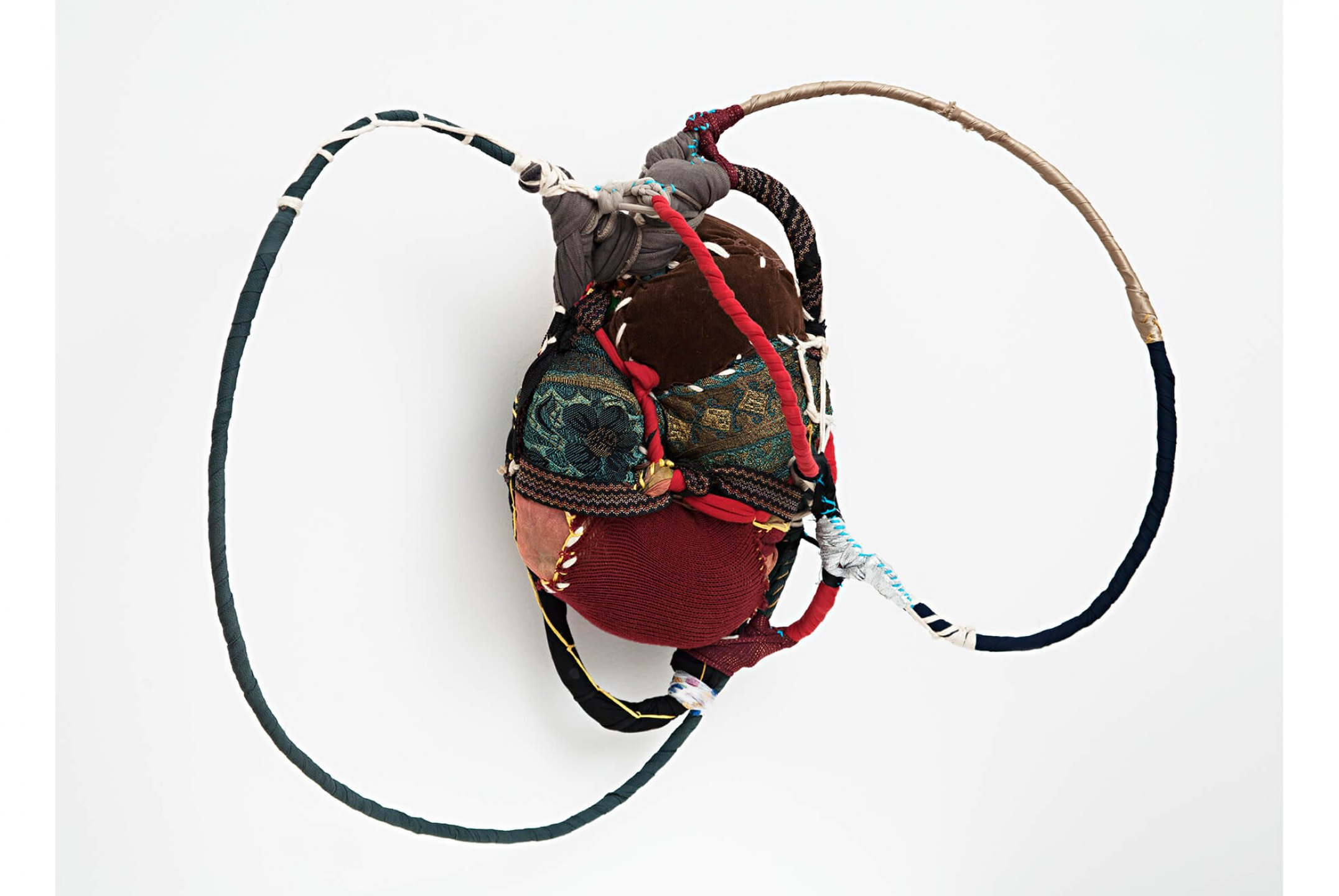Sonia Gomes,&nbsp;<em>untitled, from Patuá series</em>,&nbsp;2004, stitching, bindings, different fabrics and laces on wire, 50 × 63 × 24 cm - Mendes Wood DM