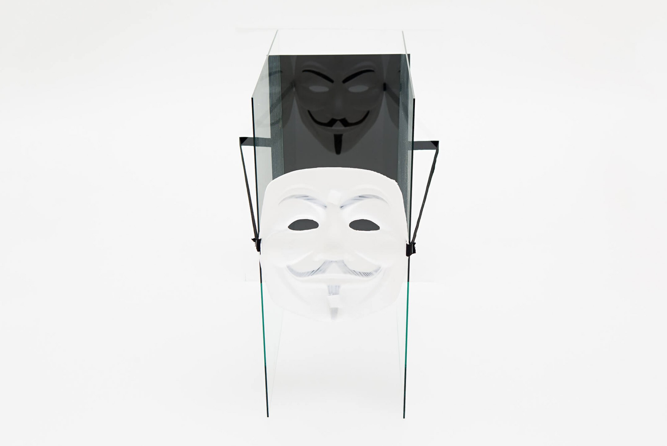 Roberto Winter, <em>Revolution institution</em>, 2014, 'Guy Fawkes' mask (painted plastic), elastic, envelope, paper and glass, 40 × 40 × 40 cm - Mendes Wood DM