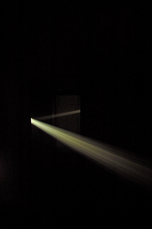 Daniel Steegmann Mangrané,<em> Bicho de nariz delicado,</em> 2013, installation view at<em> Uma Certa Falta de Coherência,</em> two slides projectors, uniques slides, mirrors, smoke, gilded, canvas - Mendes Wood DM