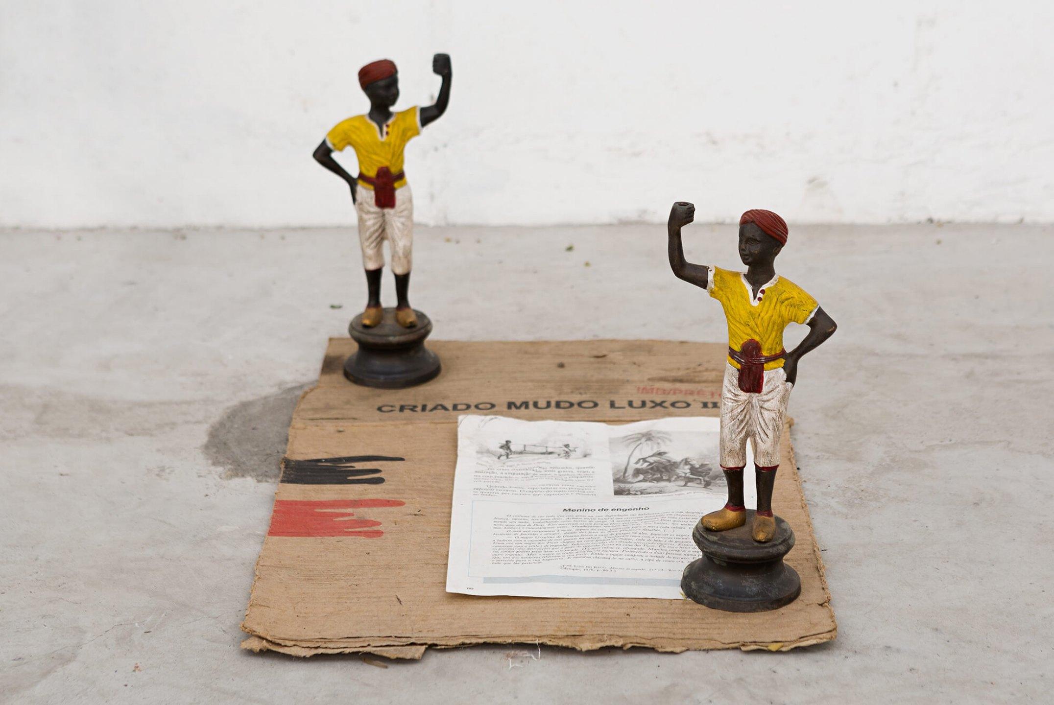Paulo Nazareth,<em>CA - criado mudo</em>,2013, bronze sculptures, cardboard and paper, 51 × 34 × 24 cm - Mendes Wood DM