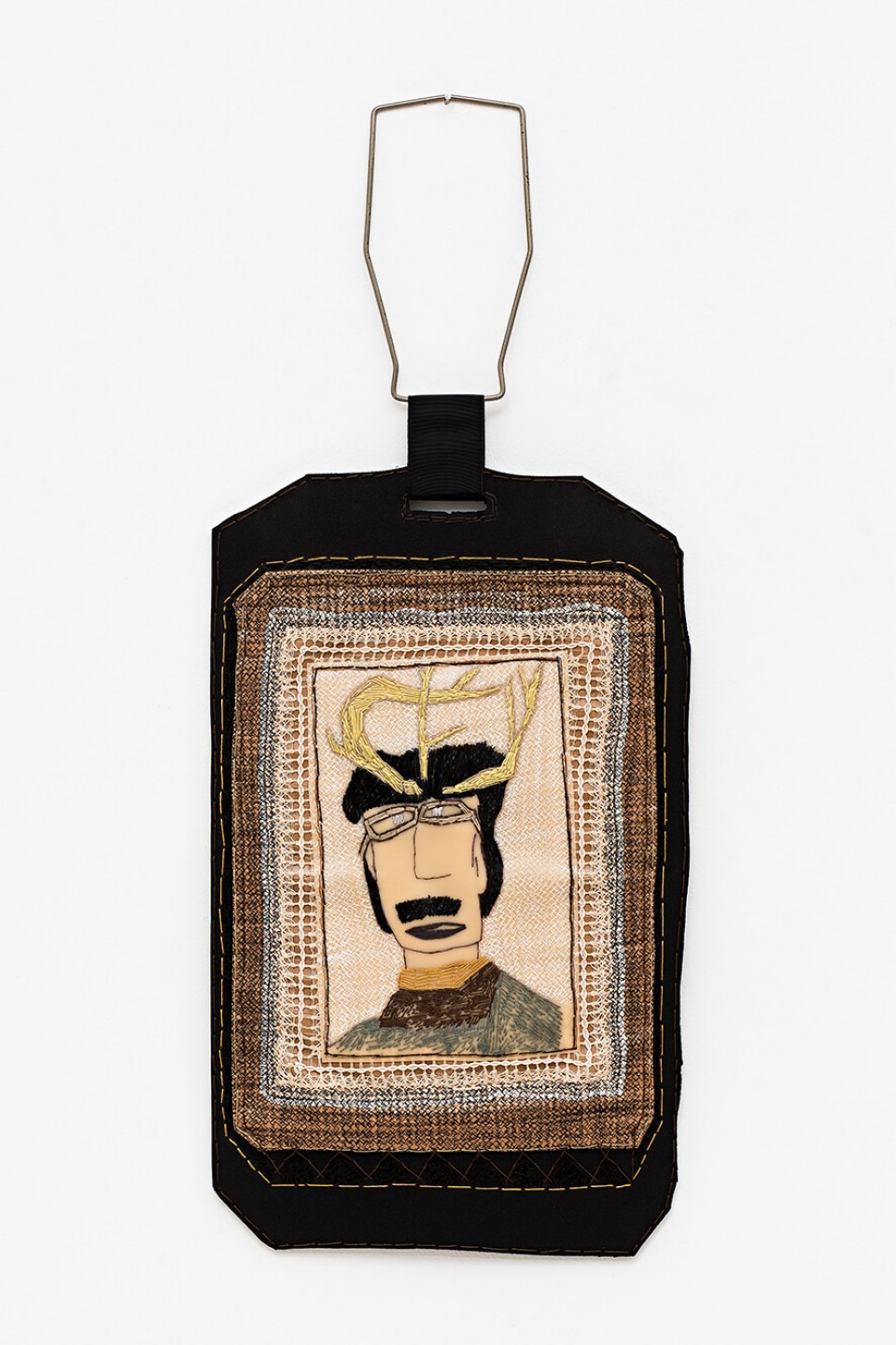 f. marquespeteado, <em>Homem Veado do Mato Grosso do Sul, from Camafeu e broches de reis, santos e homens veados series</em>, 2004, machine and hand embroidered wool, cottons and PVCs collage on a neoprene sheet,  handled by old lantern holder, 98 × 41 cm - Mendes Wood DM