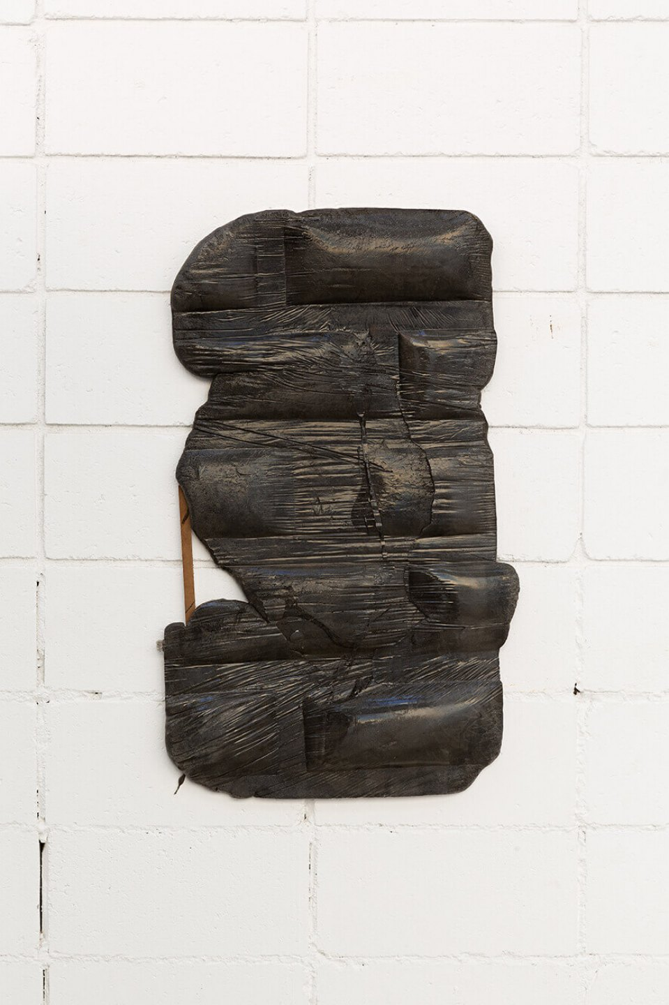 Neïl Beloufa,&nbsp;<em>Unframed dark archive, from Secured wall series</em>,&nbsp;2014, extensive foam, pigment and wood, 87 × 51 × 6 cm - Mendes Wood DM