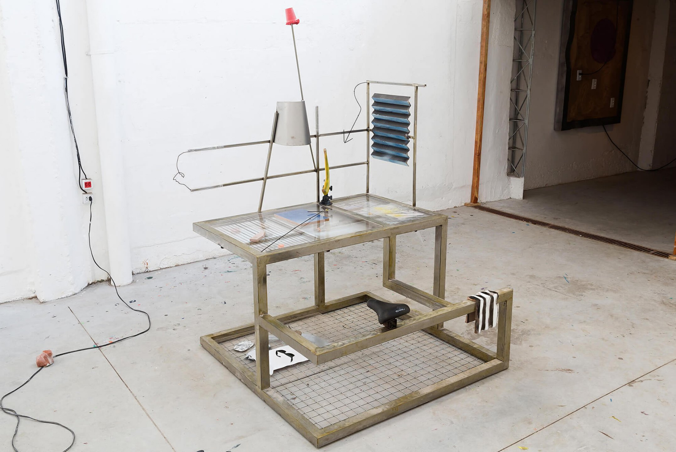 Neïl Beloufa, <em>Desk, trust and control, health, from inside, a beautiful sky</em>, 2014, acrylic, iron and steel, aluminum, photographic print, foam and leather, polyurethane, concrete, wood, plastic, acrylic paint, 192 × 125 × 125 cm - Mendes Wood DM