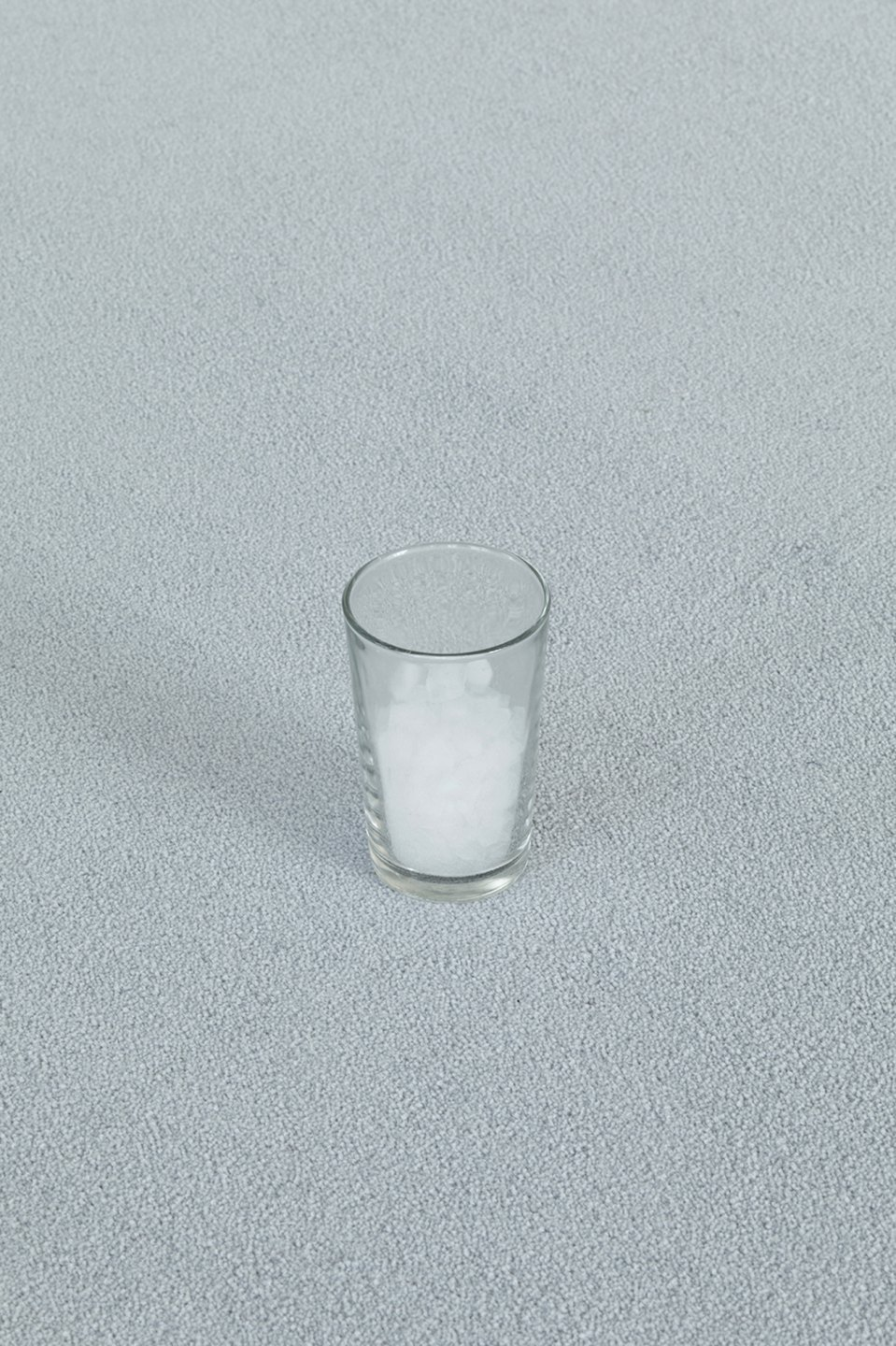 Nina Canell,<em>&nbsp;Interiors (Condensed)</em>, 2012,&nbsp;congealed air, drinking glass, fitted carpet<br> - Mendes Wood DM