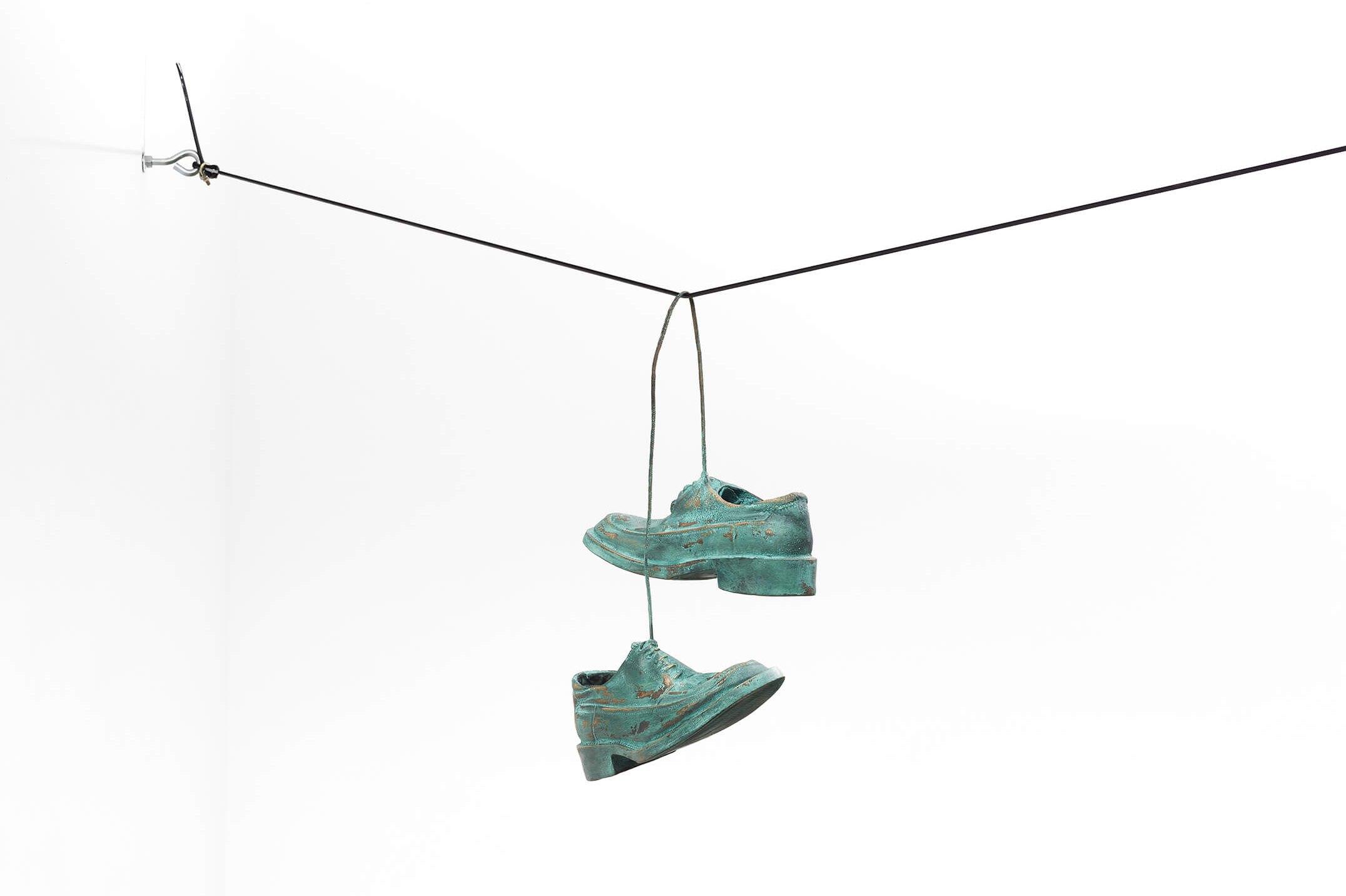 Haroon Gunn-Salie,<em> On the line,</em>2016,pair of shoes bronze plated,46 × 32 × 18 cm - Mendes Wood DM