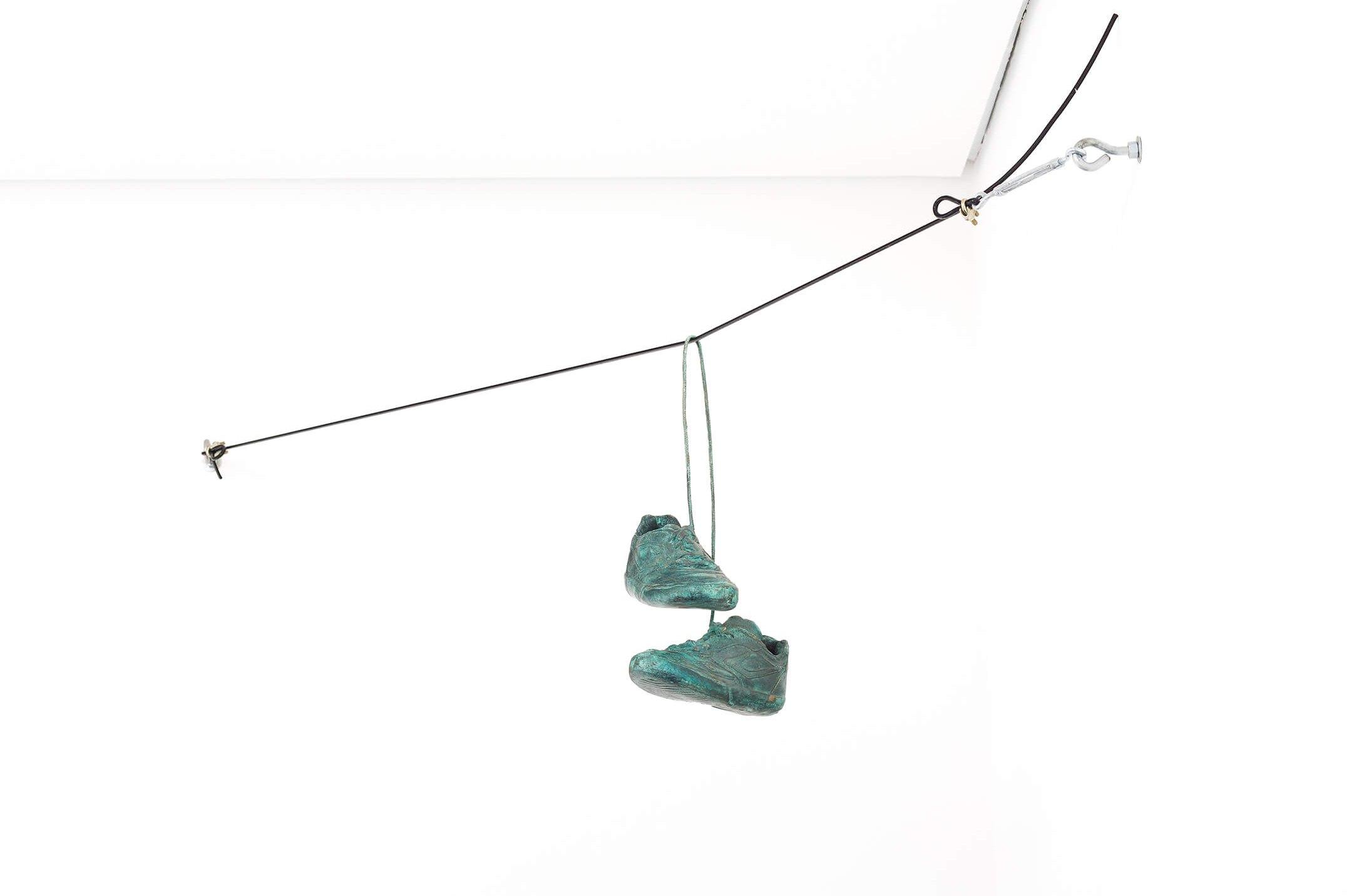 Haroon Gunn-Salie,<em> On the line,</em>2016,pair of shoes bronze plated,40× 22 × 26 cm - Mendes Wood DM