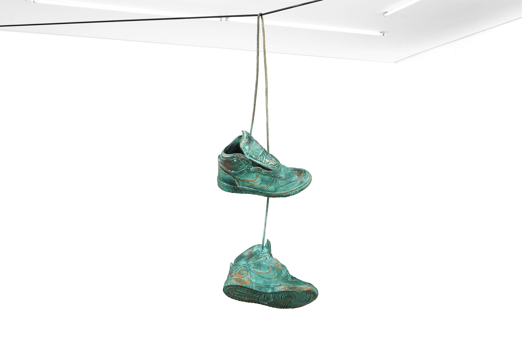 Haroon Gunn-Salie<em>, On the line,</em>2016,pair of shoes bronze plated,78 × 32 × 29 cm - Mendes Wood DM