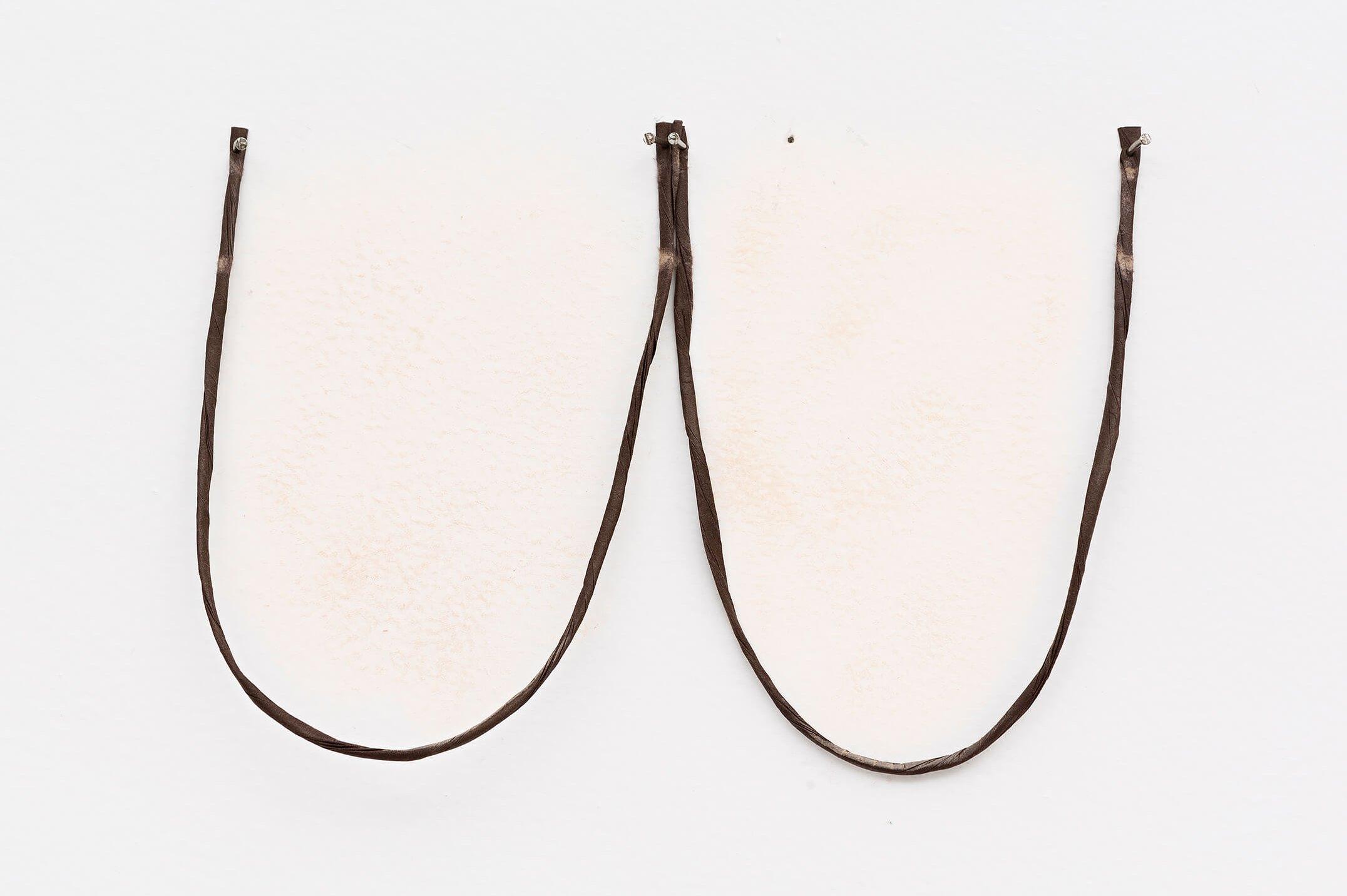 Adriano Costa,<em> MAC Balls</em>, 2015, MAC NC37 foudation and bag strap, 12 × 22 cm - Mendes Wood DM