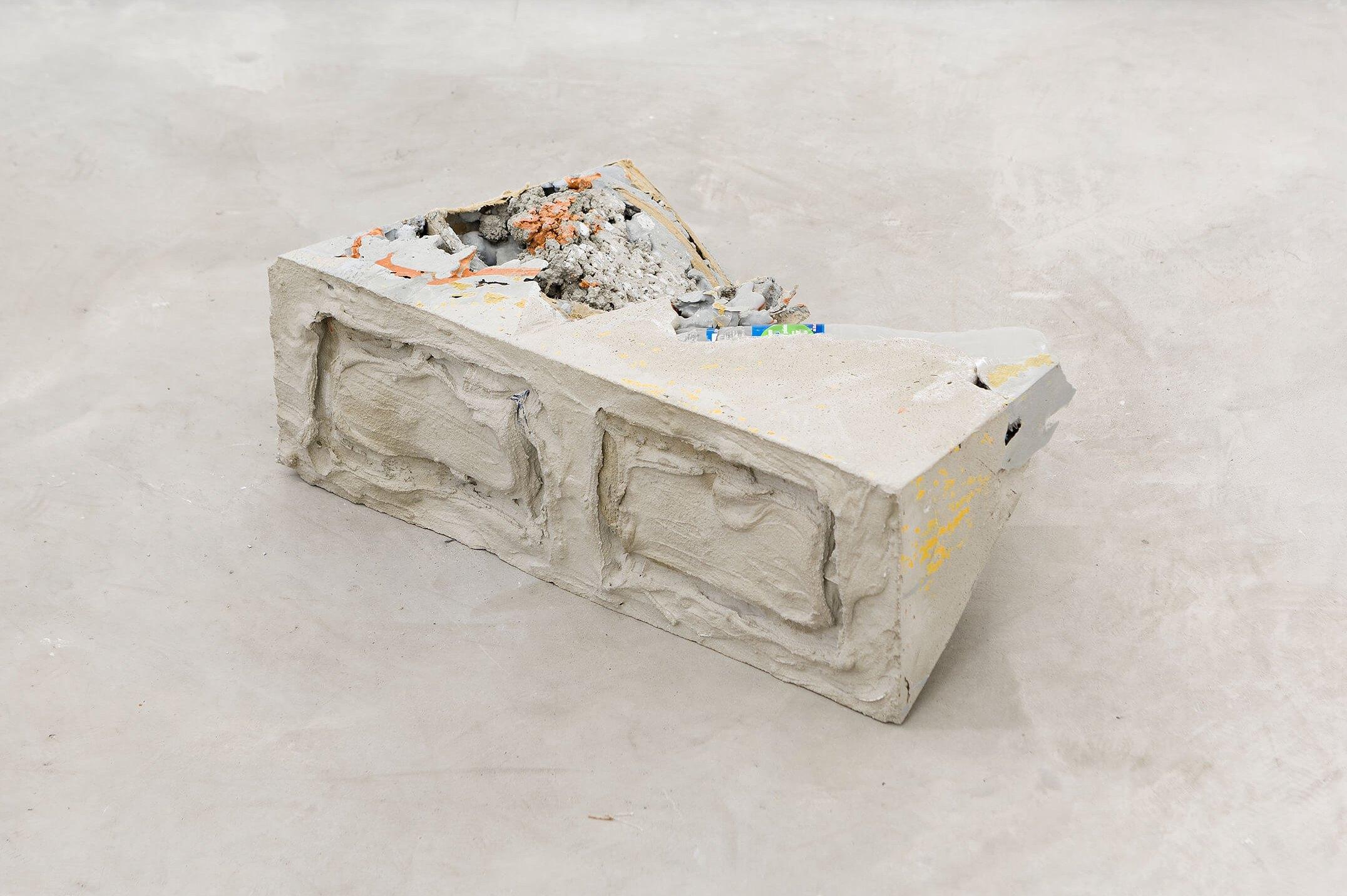 Allyson Vieira, <em>Block 5</em>, 2015, concrete, <em>Worker</em> scraps, concrete blocks, 15 × 39 × 20 cm - Mendes Wood DM