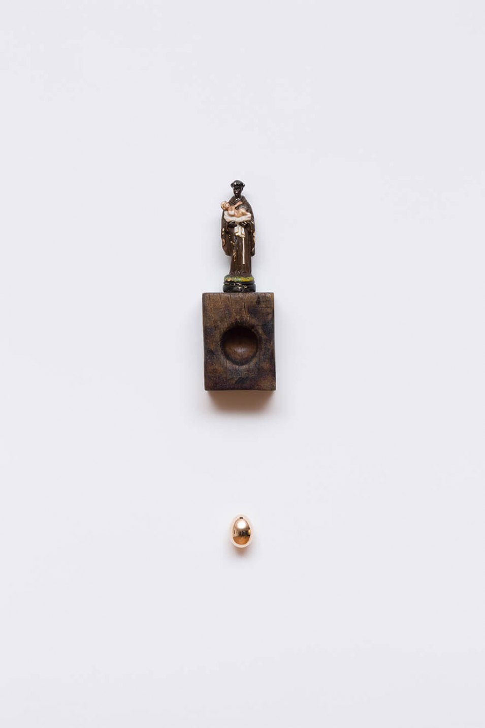Antônio Obá, <em>Oratório I,</em> 2017, sculpture in plaster, wood pestle and bronze object, 60 × 12 cm - Mendes Wood DM