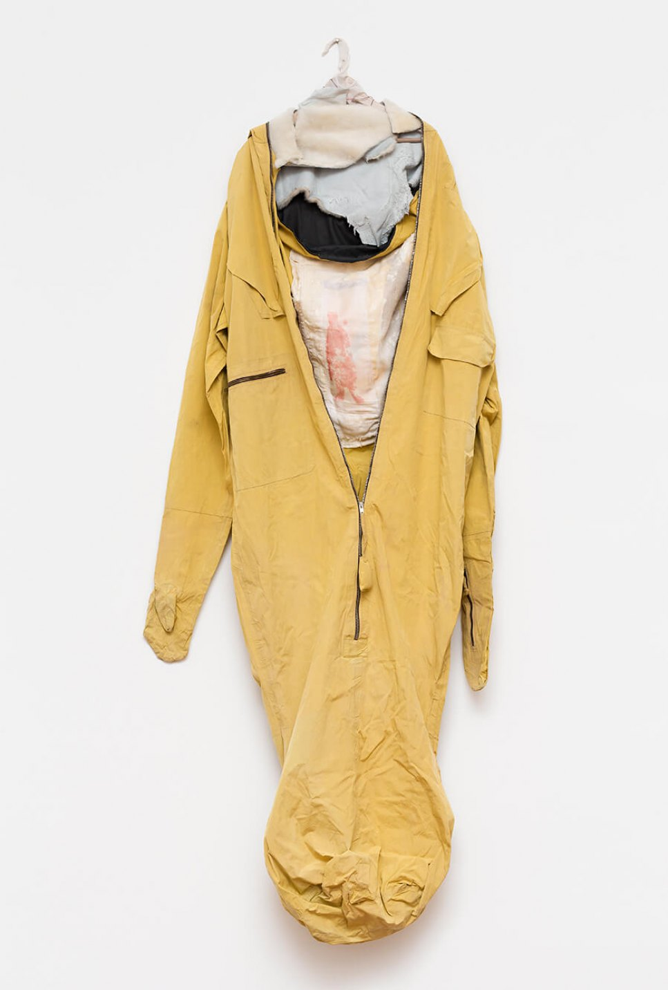 f.marquespenteado,<em> Proteger Sean</em>, 2014, synthetic  ber sleeping bag, with hand and machine embroidery, and wood hanger with lamb skin, 187 × 80 cm - Mendes Wood DM