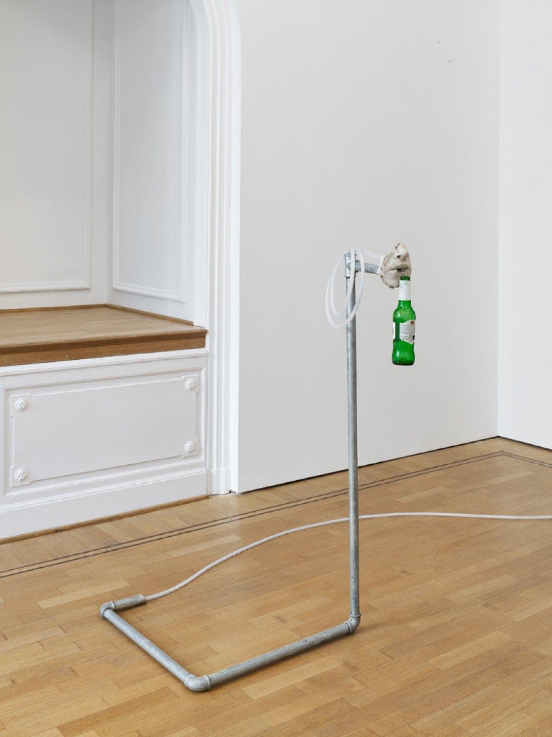 Giulio Delvè,<em>Uff</em>, 2017, jesmonite, air compressor, beer bottle, pipes and  ttings,  exible hydraulic hose, 120 × 60 × 55 cm  - Mendes Wood DM