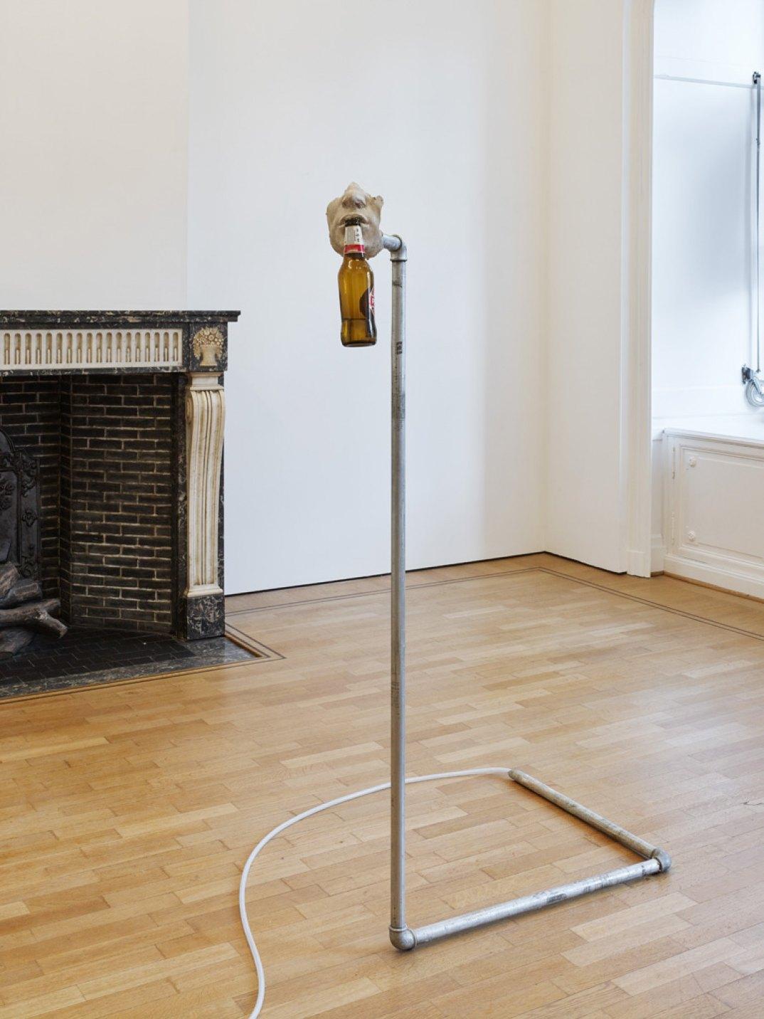 Giulio Delvè,<em>Ugh</em>, 2017, jesmonite, air compressor, beer bottle, pipes and ttings, exible hydraulic hose, 120 × 60 × 55 cm - Mendes Wood DM