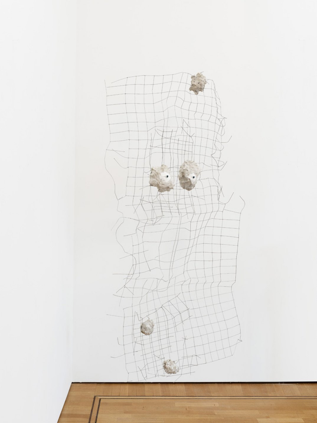 Giulio Delvè, <em>Not our ideology, not ourbelief, not our objectives; Whatremains, therefore, keep an eyeon you</em>, 2017, wire mesh, glass eyes, plaster, mortar, concrete, 185 × 100 × 10 cm - Mendes Wood DM