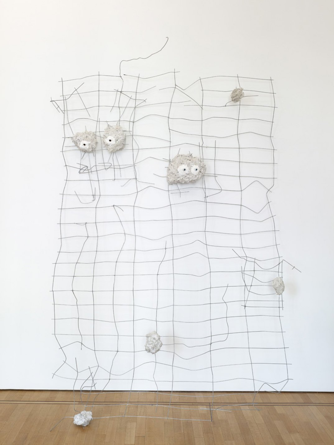 Giulio Delvè, <em>Failed any attempt to involve you as part of our crowd; Whatremains, therefore, keep an eye on you</em>, 2017, wire mesh, glass eyes, plaster, mortar, concrete, 255 × 175 × 20 cm - Mendes Wood DM