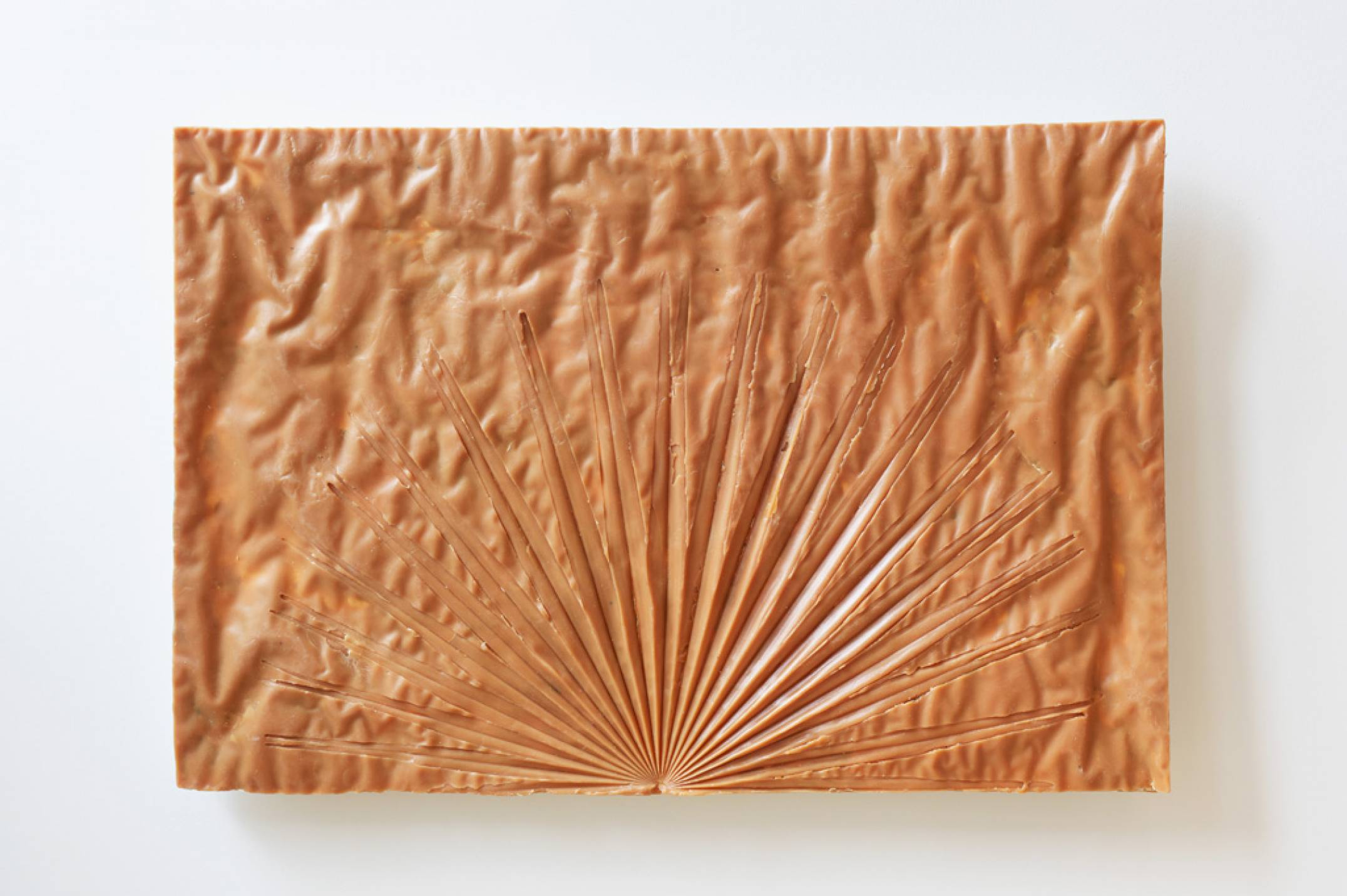 Giulio Delvè, <em>Your amber skin caressed by the rays of sunset</em>, 2017, carnauba wax, beeswax, plaster, 50 × 75 × 5 cm - Mendes Wood DM