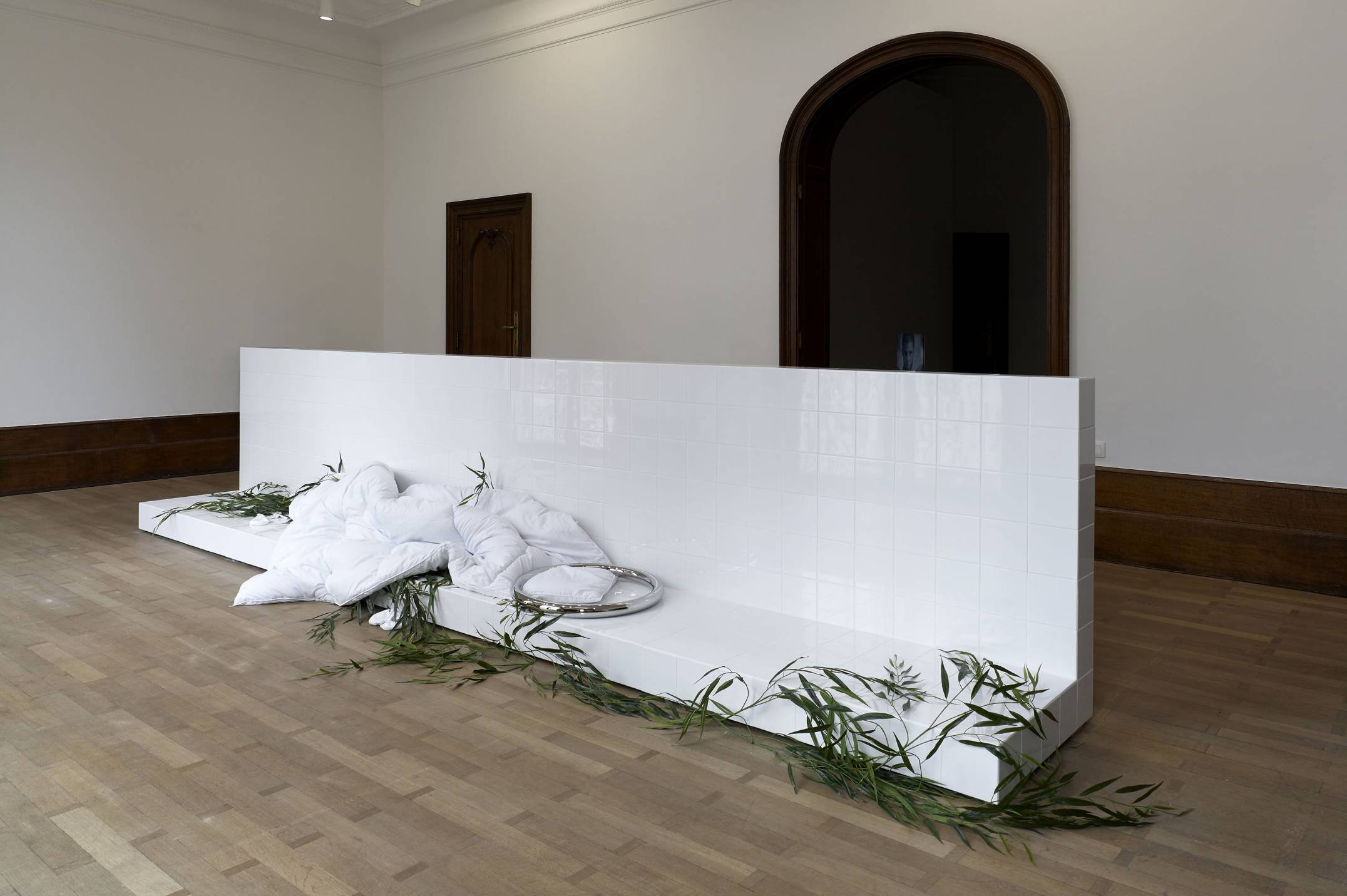 Prem Sahib,<em> Heron,&nbsp;</em>2017, socks, wood, ceramic tiles, grout, polished steel, duvet, artificial willow branches, 105 × 510 × 75 cm - Mendes Wood DM
