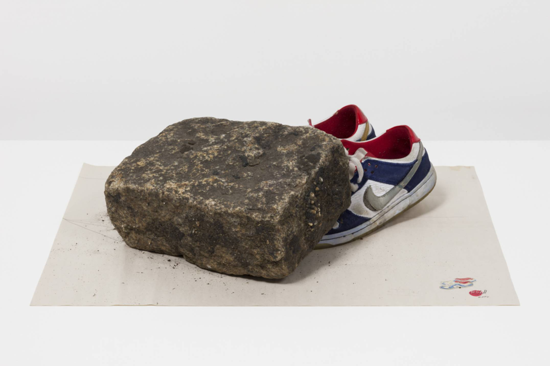 Paulo Nazareth, <em>NICE</em>, 2017, pencil on paper, stone and sneakers, 23 × 61 × 45 cm - Mendes Wood DM